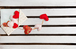 Lot of hearts in envelope on white wooden background Royalty Free Stock Photos