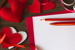 Lot  hearts of felt, paper tape, pencil and pen Royalty Free Stock Photography