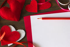 Lot hearts of felt, ribbon and paper pencil Stock Image