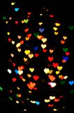 A lot of hearts. Many colored lights on a black background in the form of hearts stock photo