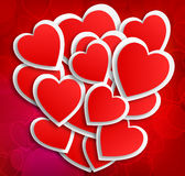 Lot of hearts on red background Stock Images