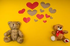 A lot of hearts and two teddy bears on the yellow background stock images