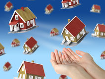 Lot of houses falling from sky. Stock Photography