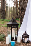 A lot if candles on candlesticks and in lanterns Royalty Free Stock Photos