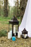 A lot if candles on candlesticks and in lanterns Royalty Free Stock Images