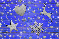 Lot of iron star, heart, dear and snowflake on weathered blue wooden board Royalty Free Stock Photography