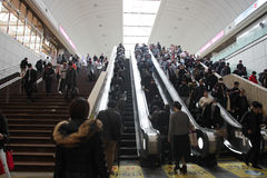 A lot of Japanese peoples at escalator of Tokyo train station in Japan on April 1, 2017 Royalty Free Stock Photo