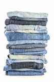 A lot of jeans on white background Stock Photos