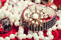 Lot of jewellery close up in red velvet box, ring bracelet with perl Stock Image