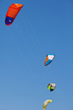 A lot of kiteboarding kites in the blue sky Royalty Free Stock Image