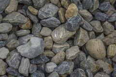 Lot of large multi-colored gravel stones. blue, white and gray stones in one pile royalty free stock photo