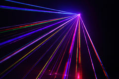 Lot of laser beams in dark at disco. Lot of beautiful multi-colored laser rays in dark at disco Royalty Free Stock Photography
