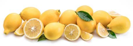 Lot of lemon fruits with lemon leaf isolated. Horizontal photo. stock image