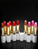 A lot of lipsticks. A lot of lipstick over a black background Stock Image