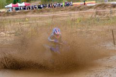 A lot of liquid mud. SERPUKHOV, RUSSIA - OCTOBER 7, 2017: Nikolaev Maksim 13,  Class ATV-JUNIORS, in the 4 stage  MX series, the Red Wings Cup 2017 super country Stock Image
