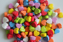 A lot of the little colorful hearts for Valentine`s Day. Stock Photos