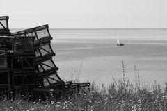 Lot of lobster cages by the sea. Black and white - stock photos Royalty Free Stock Photography