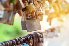 A lot of love padlocks. On the bridge Stock Photo