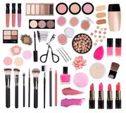 Makeup cosmetics such as eye shadow, mascara, lipstick, eyeliner, nail polish and makeup accessories isolated on white background stock photo