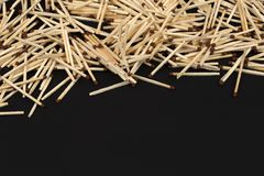 A lot of matches on dark background with space for text royalty free stock photo