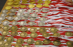 A lot of medals. Many gold, silver and bronze medals waiting for the winners royalty free stock photography