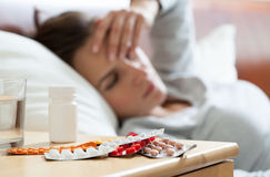 A lot of medicines on night table Stock Photos