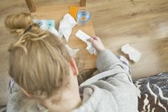 Frustrated and tired woman with a lot of medicaments. A lot of medicines on night table in bedroom. Frustrated and tired woman Stock Photography