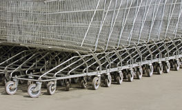 A lot of metal carts on wheels Stock Images