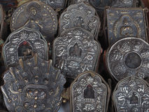 A lot of metal precious artifact with the election of chasing Buddhist subjects, in the middle of Buddha figure, ancient religious. A lot of metal precious Royalty Free Stock Photography