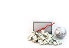 Lot of Money on Computer Laptop with business arrow background. 3D rendering graphic design is 100 dollar bills as heap on computer and arrow chart of business Stock Photo