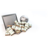 Lot of Money on Computer Laptop with world background Royalty Free Stock Photo