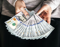 A lot of money in female hands. Business. Dollars and prosperity. A royalty free stock photo