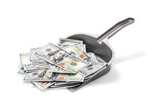 Lot of money on garbage scoop. Pile of dollars on a plastic garbage scoop isolated on a white background Stock Photos
