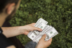 A lot of money in the hands Royalty Free Stock Photo