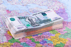 A lot of money are on the map, the money on travel Royalty Free Stock Photo