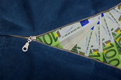 Lot of money out of the euro banknotes.  Money zipper concept Stock Photo
