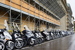 A lot of mopeds on the city street Royalty Free Stock Photos