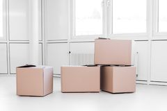 A lot of moving boxes. In a empty white room royalty free stock photography
