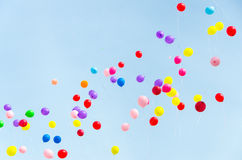 A lot of multi-colored balloons into the sky Royalty Free Stock Photo