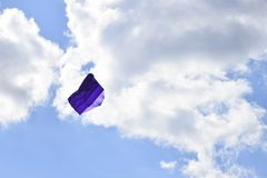 Lot of multi-colored kites in the sky vertical background stock photo