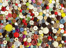 Lot of multicolor plastic old vintage different clothing buttons. Pattern background Stock Photos