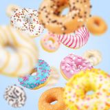 Lot of multicolored donuts on blue royalty free stock photos