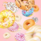 Lot of multicolored donuts stock images