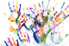 A lot of multicolored hand prints on white stock photo