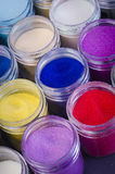 Lot of multicolored paint in jars for makeup artistry Royalty Free Stock Photo