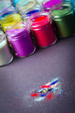 Lot of multicolored paint in jars for makeup artistry. A lot of multicolored paint in jars for makeup artistry stock image