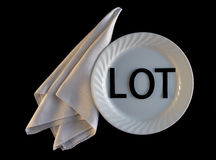 LOT On My Plate With Napkin on Black Background Royalty Free Stock Photo