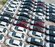 Novorossiysk, Russia - May, 18, 2017: A lot of new cars toyota corolla parked on the site for sale. View from above Stock Photos
