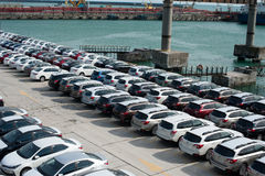 A lot of new cars toyota corolla and Subaru Forester are unloaded at the seaport Stock Photos