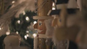 Lot of nutcrackers in a xmas decoration. Many nutcrackers in a christmas decoration before xmas, with lights stock video footage